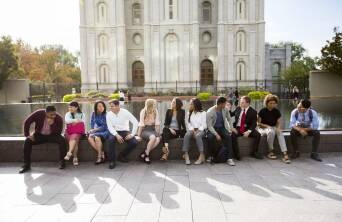Students sitting in front of the SLC temple.