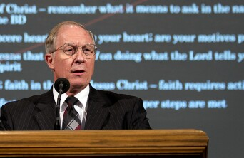 David Brown speaking at a pulpit.