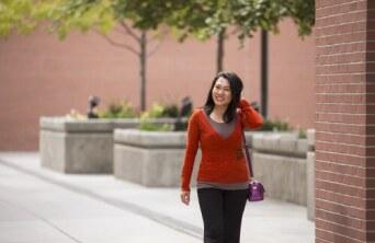 Girl walking by herself outside.
