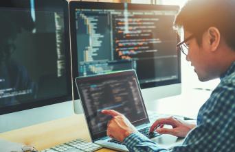 programmer analyzing code