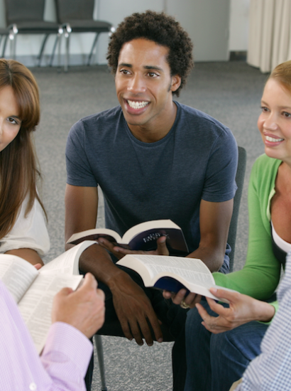 group of students studying scriptures