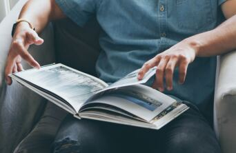 man flipping through a catalog
