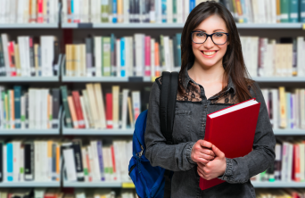 Smiling female student in library
