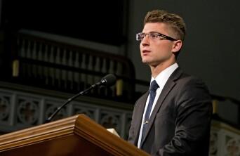 Elijah Taylor talking at the pulpit.