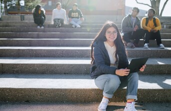 Students sitting on steps at College
