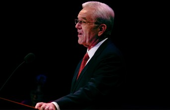 Larry Gelwix speaking at a pulpit.