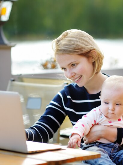 Mom working on homework with her baby