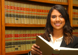 paralegal studying in legal section of library