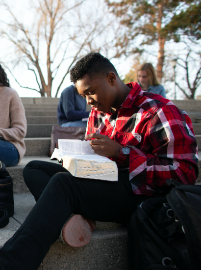 student studying the scriptures outside