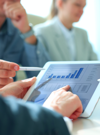 pointing to analytics on a tablet