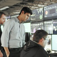 Men working in a network and security office