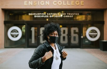 Student with mask by entrance
