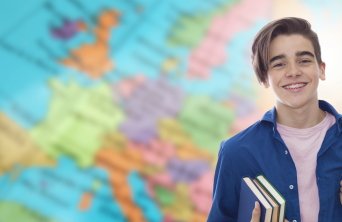 new student in front of world map
