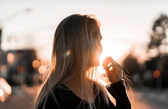 young woman turning into the sunlight