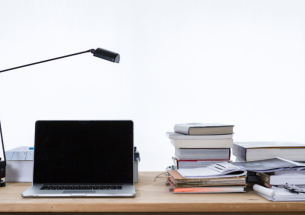 laptop and books on a desk