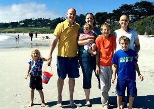 Steve Dobb with his family on a beach.