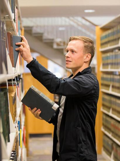 A student checks out a book at the bookstore