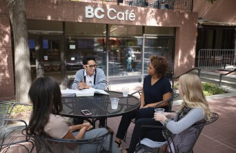 Students talking outside the BC Cafe