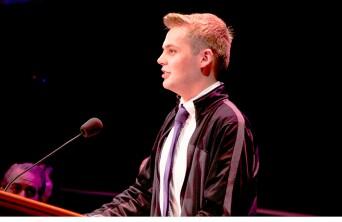Daniel Carter speaking at a pulpit.