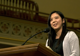 Huang speaking at the pulpit.