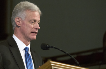 BYU President speaking at a pulpit.