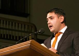 Danilo Mantilla speaking at a pulpit.