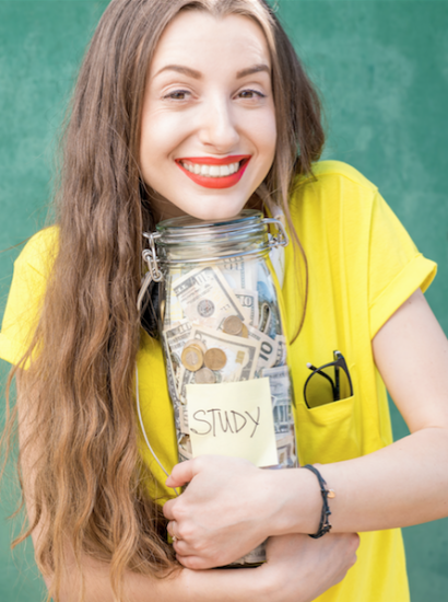 female student holding jar of money