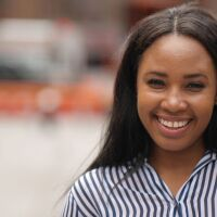 young smiling black woman in city