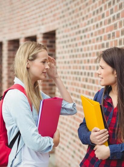 Female students talking outside